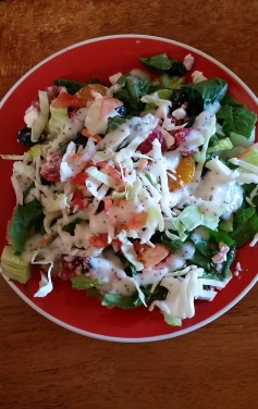 Summer Sweet Fruit Salad: 2-3 cups greens (lettuce, spinach, cabbage, etc.), 1 cup chopped fruit (ex: mandarin oranges, blueberries, strawberries), 1/4 cup crumbled feta cheese, 2-3 tbs. poppyseed dressing.