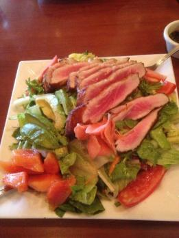 Ahi Tuna Salad: lettuce, spinach, seared tuna (you can substitute seared salmon as well!), 1 hard boiled egg, pineapple slices, mango slices, dressing of your choice!