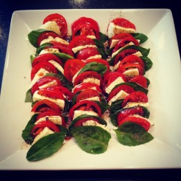 Caprese Salad: 1-2 tomatoes (sliced thin), 1 cup basil leaves, 1/2 block Mozzarella cheese (sliced thin). Assemble and pour balsamic vinaigrette on top!