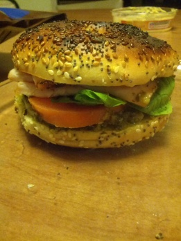 Big Bagel Sammich: 1 everything bagel (toasted), meat of your choice (I like peppered turkey, garlic herb chicken, or ham best!), lettuce, tomato (sliced), 1 slice provolone cheese, dressing/sauce of your choice! (Some of my favorite sauces to add are pesto, Dijon mustard, or a balsamic spread!)