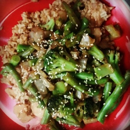 Good Ole Stir-Fry: Ingredients: 2 cups chopped green beans, 1/4 chopped onion, 3 tbsp teriyaki sauce (I use the thicker La Choy brand marinade/sauce), 2 tbsp soy sauce, 1 tbsp olive oil, 1 lb. chicken breast, 1/4 cup chopped broccoli, 1 tbsp sesame seeds, 1 tbsp minced garlic, 2 cups rice