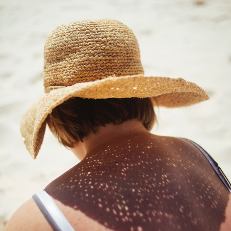 girl with sun hat on the beach